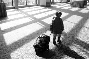child traveling alone